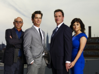 WHITE COLLAR -- Pictured (l-r): Willie Garson as Mozzie, Matt Bomer as Neal Caffrey, Tim DeKay as Peter Burke, Tiffani Thiessen as Elizabeth Burke  -- USA Network Photo: Nigel Parry